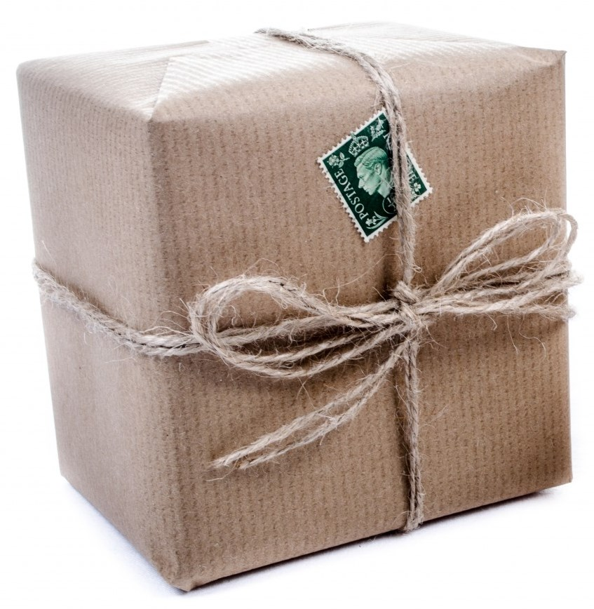 Box wrapped with paper and string.
